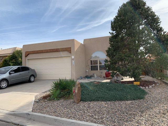 Well maintained home located near the Tierra Del Sol Country Club. This beautiful home features tongue and groove raised ceilings with vigas in the living room, a cozy gas log fireplace, nichos and custom wood doors throughout. The abundance of windows let in lots of natural light. The back yard features easy care landscaping and a pergola as well as a back covered patio that are perfect for entertaining.