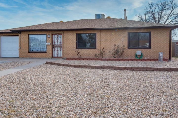 Terrific location close to Uptown, shopping, dining, parks, UNM!  3BDR/2BA/1CG!  Versatile floor plan with 3 living spaces; combined living & dining space, separate hobby/office/bdr, plus large family room/den with cozy wood fireplace.  NEW SHINGLE ROOF (2017-1018) Updated furnace (2017) Updated water heater!  Lots of light, skylights, ceiling fans, separate utility room!   Kitchen features new gas stove, lots of cabinets, tile floor, breakfast bar and is open to the dining room.  Outdoor living space with covered patio and walled for privacy and storage shed.