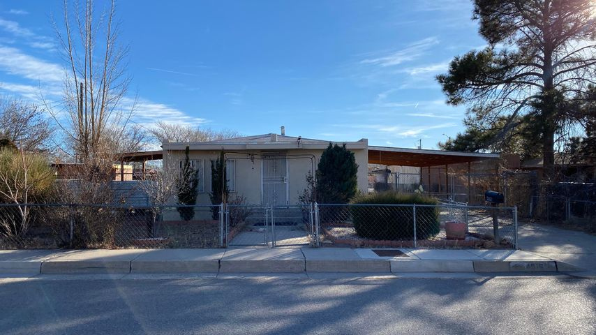 Wonderful starter home or investment. Home is located on .25 acre of land with back yard access. The main home offers an updated master bathroom, custom built porch and carport. There are 3 possible bedrooms in the home. Close to Old Town, Albuquerque/'s Westside. Home is sold as-is where is, No warranties expressed or implied.