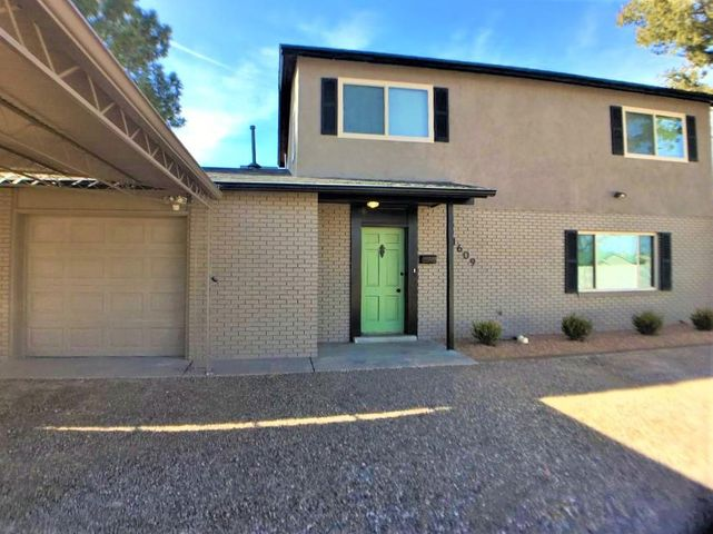 This stunning Ridgecrest estate has just undergone an extensive ground-up remodel. Spacious new designer kitchen includes new cabinetry, new granite counters and all new stainless appliances. 2 large family rooms. 3 beautifully updated bathrooms including all new tile, cabinetry and fixtures. All new flooring, texture, paint, trim and hardware throughout. New Low-E windows, new updated electric service, new xeriscaping front & rear. Completely finished 2.5 car garage with openers, covered parking in front, and a huge circular drive.  New roof and new mastercool unit. Beautiful mountain and city views from master BR and leafy ridgecrest view from home office. Closets galore! Backyard has 3 sheds and access from rear alley. This freshly remodeled home is literally turn-key and move-in ready.