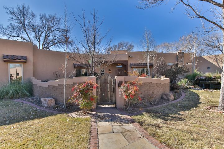 This is the one you've been waiting for! A single-story custom home in a gated Los Ranchos community is the perfect one for you! Oversized space with large open floorplan you'll find lots of extra amenities like the refrigerated wine room and theater room.  The oversize kitchen boasts Wolf Subzero appliances and skylights to fill the room with natural light all open to living area. The master will be your favorite room as it's spacious and has a very oversized walk in closet! Backyard offers outdoor kitchen and cherry trees with access to the ditch and apple orchard! Needing more room? There's a 300 sqft casita to fit your needs with its own entrance for guests or separate office/gym!