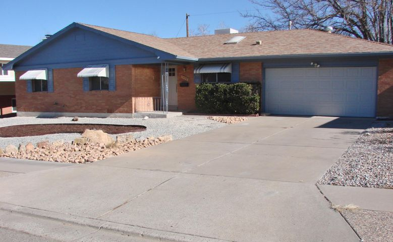 You will love this updated/remodeled brick Mossman located in a very desirable Uptown neighborhood and Sandia school district. Just minutes away from Coronado Mall and ABQ Uptown. The many updates include a newer roof. New furnace and hot water heater. The home features 2 separate living areas, a dining room and a spacious remodeled kitchen with new stainless steel appliances. Remodeled bathrooms, lots of new lighting fixtures and beautiful refinished all natural wood flooring through out the home! Large 2 car garage and outside enjoy the private backyard with covered patio. Take the great feeling you get in this super nice move in ready home and make it yours today!