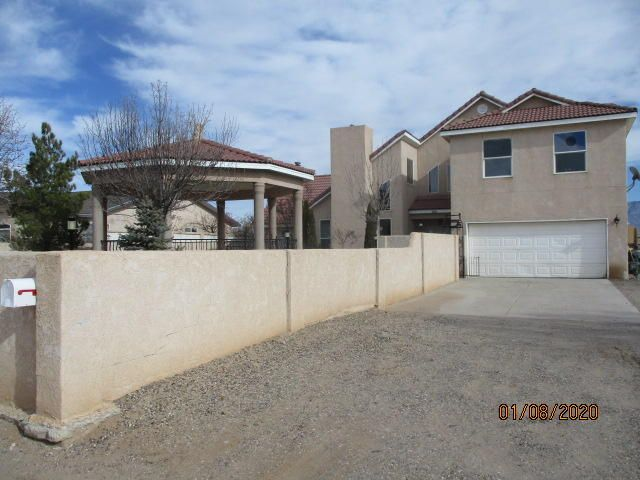 Custom home located in the desirable Rio Rancho Estates.Great views with backyard access.Many upgrades throughout the home.Including granite counter tops, fireplace and wood stove.  Open loft area upstairs. Very close to Rust Hospital and new shops in the area. Fully landscaped front yard with custom gazebo.