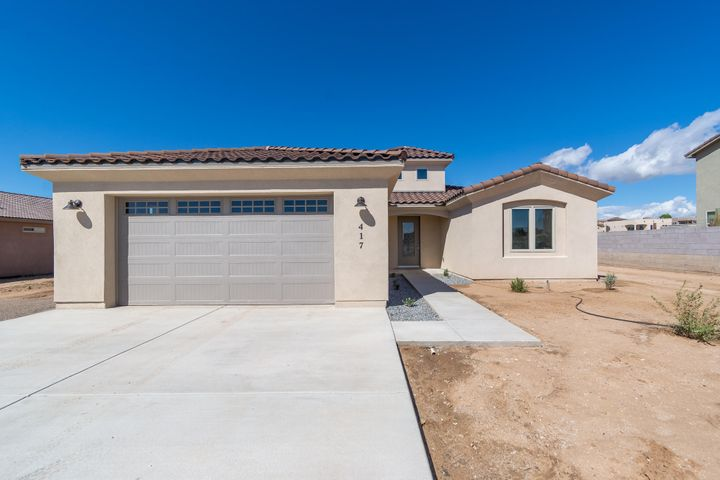 Brand new single story by PS Custom Homes located on a large 1/2 acre property in Rio Rancho! Home features 2,360sf with 4 bedrooms and 3 bathrooms! Great open floorplan with raised ceilings and a beautiful tower entry way! Large living area with a custom fireplace. Kitchen with upgraded cabinetry, countertops, built-in oven/microwave, cooktop, dishwasher, refrigerator, pantry and a kitchen island with seating space. Spacious master suite with coved ceiling and a private bath! Bath hosts dual sinks, an oversized vanity, walk-in shower with custom surround and walk-in closet! 3 additional guest rooms split from the master. Outside enjoy the covered patio a large backyard!