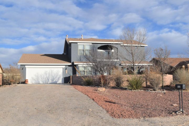This home is a GEM! 2788 sf with 5 bedrooms, super large rooms and a private guest or Inlaw quarters. What an amazing combination of features. Appliances are about 2 years old. Carpets look great and ceramic tile throughout the traffic areas. The home sits on a 1/2 acre lot with views of the Sandias from the master bedroom deck. Back yard access is available for your rv or other landscaping and storage needs. This huge home is extra special with its great condition and loaded with features.  If your looking for a roomy home and lots of bedrooms this is the home for you and your family.  Come on in and take a look.