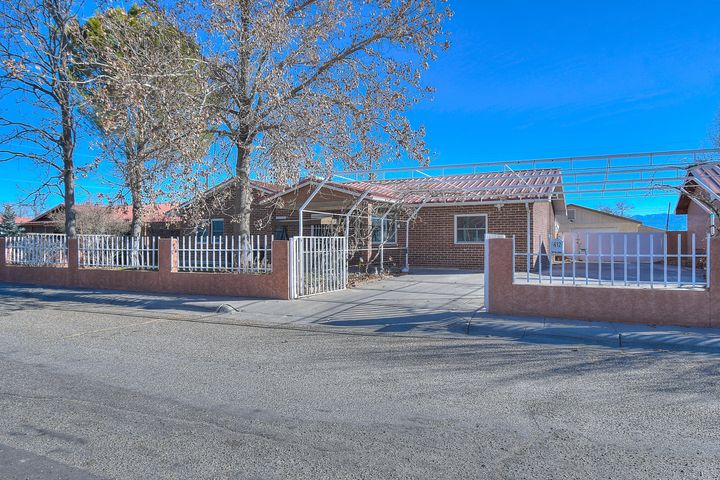 Beautiful ranch style home near main st Belen located on a  a Cul De Sac. This well maintained home nestled inside a security gate, offers side yard access. In addition to three bedrooms, this bright home features a large office that could be used as an additional bedroom as well as an  enclosed porch perfect for gatherings. The lovely dine in kitchen offers an island and stainless steel fridge and stove. This lovely home has a large backyard complete with an outdoor pizza oven and detached garage.