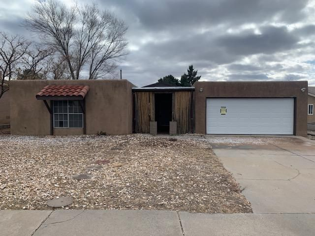 Centrally located close to Uptown shopping, restaurants and entertainment, this 3 bed, 2 bath home has several living areas and plenty of natural light. Fireplace in the main living space, saltillo tile - no carpet. Nice backyard for the mild NM weather. Lots of unique touches and accents - see it today!
