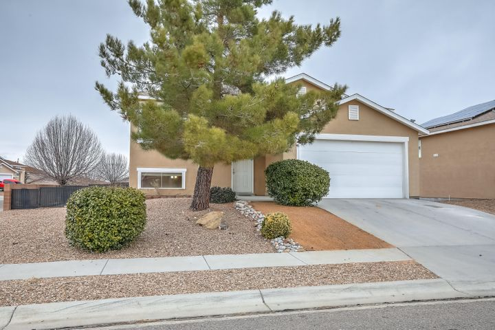 Spacious 5-bedroom home on corner lot! This home offers a unique split level design with 2 large livings areas. Fully landscaped yard and easy access to I-25 and Albuquerque. This home is surround by parks and walking trails.