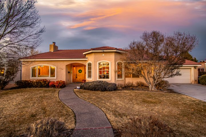 Exquisite custom built beauty located in the Hunning Castle community just a few blocks from the Albuquerque Country Club! Home features 3,380sf with 4 bedrooms, 3 bathrooms, 2 living areas and a resort style swimming pool. Spacious front living area with gleaming hardwoods and a wood burning fireplace. Chefs kitchen with upgraded cherry cabinetry, granite countertops, built-in oven/microwave, gas cooktop, refrigerator, a center prep island and high bar with seating area.  Master suite with sitting area, walk-in closet and private bath. Bath with dual sinks, jetted hot tub and a walk-in shower. Enjoy your own outdoor private oasis with a salt water pool, cedar hot tub, gazebo and fireplace!  Close to golf course, coffee shops/restaurants, Old Town and more!