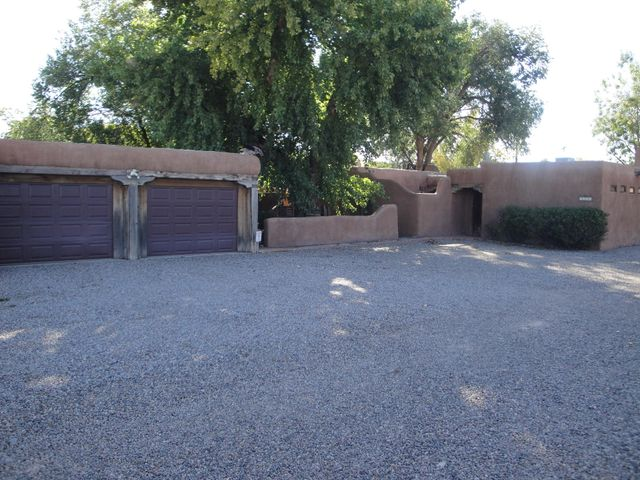 Great Value for this Secluded North Valley Adobe Property with a Guest Casita. High ceilings in Casita with kitchen and bathroom. Can be used for an Air BNB rental or other uses. 2 Living areas in Main house with 4 Kiva Style fireplaces. 3 Car Garage. Money Making opportunity on this Property!