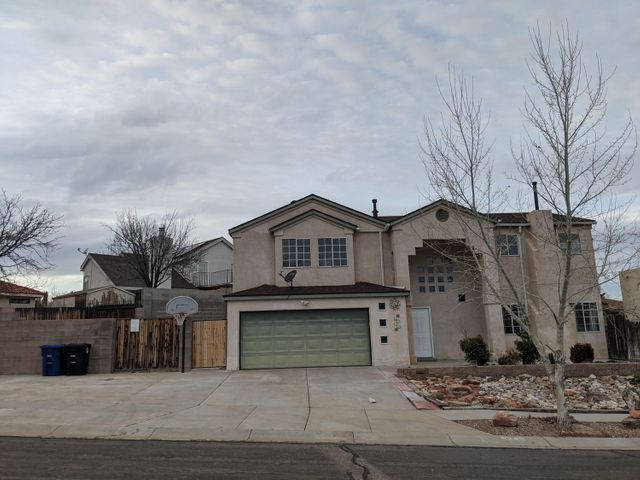 Beautiful custom home in desirable Santa Fe Village neighborhood,Volcano Vista school district, landscaped front and back, backyard access, large master bedroom, great views and accessible to petroglyphs and trails