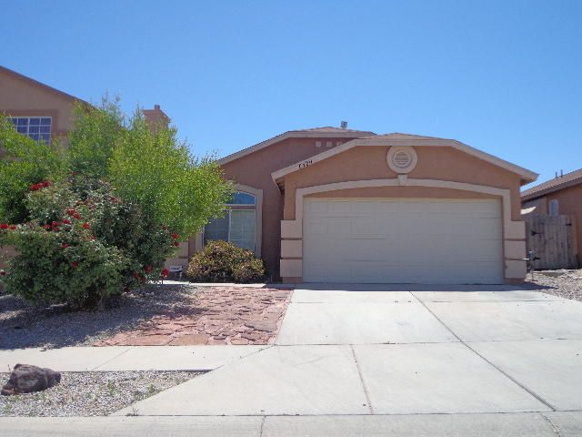 Wonderful Floorplan features Two Living Areas, Cozy Fireplace, Vaulted Ceilings and decorative ledges! Large Master Bedroom with his and her closets, garden tub, shower and double sink vanity! Custom Tile! Covered Patio! Attached 2 car garage!