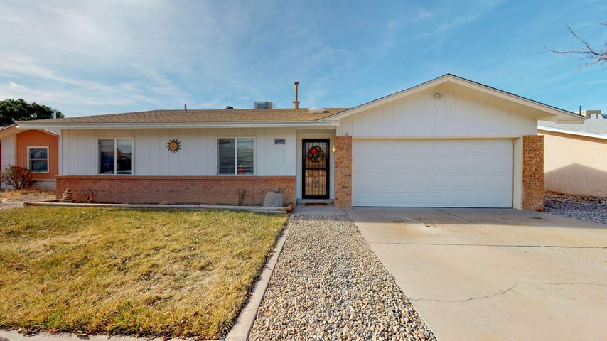 Open House Saturday 1/18: 1-3pm. CANCELLED. Just wow! Well maintained 3 bedroom/ 2 bathroom home in a friendly, quiet neighborhood. Centrally located with ease of access to I-25, Sandia Base, and paseo Del Norte. Inside boasts an updated kitchen, tons of natural light and spacious rooms. 2 car garage with enough space for all your tools and attic access for extra storage (just in case). The backyard  was completely redone-  xeriscaped for easy maintenance and new cinderblock walls with access via a wide gate for a small RV or truck. Newer roof with transferrable warranty and so much more. See you at the open house this weekend!