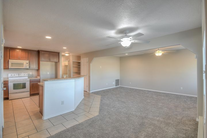Don't miss this updated townhouse!  Neutral color scheme with ceramic tile in kitchen and bathrooms.  Move in ready with  fresh paint and new carpet.  Open concept with room for entertaining.  Lots of natural light with the convenience of being close to shopping, entertainment and schools.