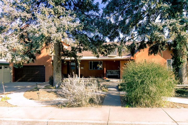 OPEN SUNDAY JAN 19 1-4 PM! Just off the greenbelts in Ridgecrest! Roof new in 2019! Generously-sized home on oversized .25-acre lot with 2-car garage & full landscaping. Northern New Mexico farmhouse design with 4 bedrooms, 4 baths, 2 living areas, coved ceiling, FP & more. Kitchen has stainless-steel appliances & opens to dining room. Upper-level master suite has east-facing Trex deck with Sandia, Manzano &  Sangre de Cristo views! Two bedrooms & 2 baths on the main level incls a remodeled full bath. Add'l guest room + bath in basement. Recent paint. Recent vinyl floor laid over original hardwood. Double pane windows. Outside finds north-facing cov patio, fountain, fire pit, play area, cherry trees & backyard with sprinklers & bubblers. The location is close to Nob Hill, KAFB/VA & UNM!