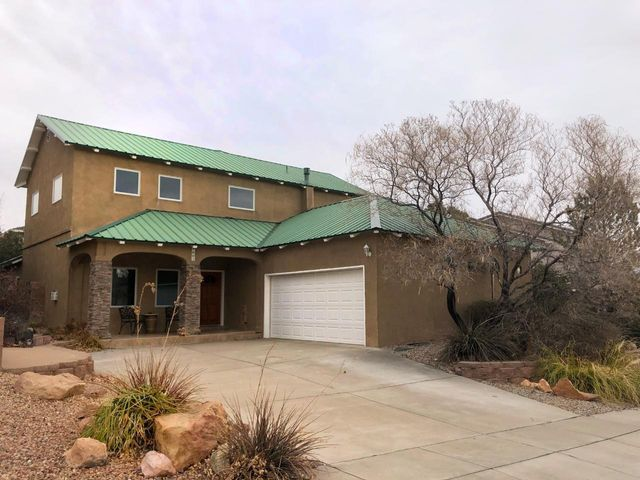 Beautiful Custom built home in a cul de sac in the Paradise Knolls neighborhood. Great views with high wood beam ceilings. Kitchen has granite counter tops.  Home is roomy with lots of living space. Large garage, tile floors, metal roof and no HOA. Bring your buyers this home is ready to move in.