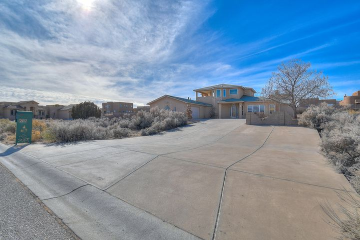 Beautiful custom built home on a private 1 acre lot in exclusive NW Albuquerque subdivision containing only 23 properties, all on 1 acre lots. Walk in to this magnificent open, spacious floorpan and be amazed. Fully remodeled boasting plenty of natural light. All new interior, including Pella windows, carpet, paint, cabinets, and appliances. 4 zone radiant heat and brand new refrigerated air unit will keep you comfy all year long. Huge gourmet kitchen features granite counter tops, stainless steel appliances, stainless steel apron sink, and an abundance of counter space and cabinetry. Enjoy 2 living spaces, 3 large bedrooms, dining, laundry, oversized finished garage with workshop area, and tons of storage downstairs.Upstairs you will find your private master suite with beautiful new
