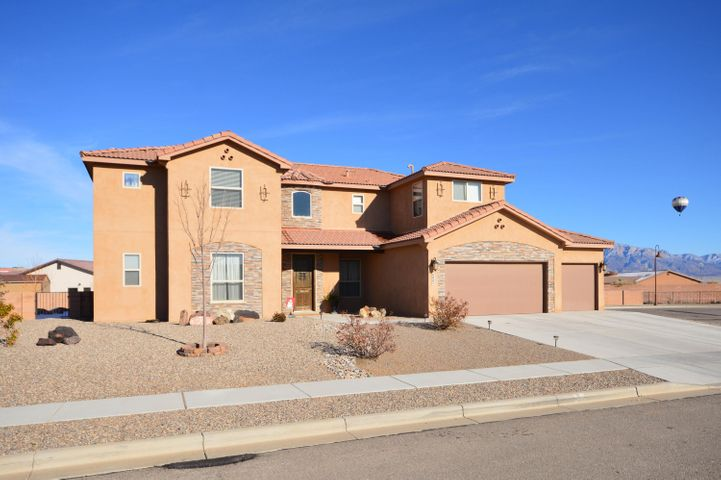 Located in a private gated community on a large cul-de-sac lot, this beautiful 5 bedroom home has a bright open floorplan with a large greatroom with soaring ceiling and custom gas log fireplace. Kitchen has granite counter tops, stainless appliances, lots of cabinets, breakfast nook and large island/bar, two pantries and mud room. First floor master bedroom has private patio, two walkin closets and bath with dual sink vanity, jetted tub and snail shower. Second bedroom and media room/study on first floor. Upstairs has 3 bedrooms, 2 full baths including Jack and Jill bath and large loft with sitting area and builtin in desk and book shelves. Backyard has covered and open patio areas. Mountain views from loft and backyard. Home is centrally located and within walking distance to schools.