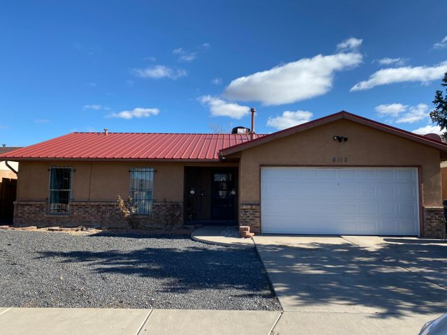This Charming 3 bedroom home located in Taylor Ranch neighborhood features a metal roof, spacious living room with fireplace and built-in shelves, open kitchen with granite countertops. Master bathroom has his and her vanities. All bedrooms have laminate flooring.  Nice size backyard.