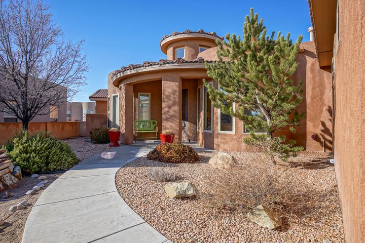 Virtual 3D Walkthrough Tour in Photo Tab! Custom Contemporary 1 Level. Amazing Sandia Views! End of Cul-de-sac. 5 Bdrm, 4.5 Bath, 3 Car. Finished lower level suite & bonus room. Travertine floors; radiant heat; skylights; 2 fireplaces; central vac, solid 6-panel doors.Tall windows for Sandia Mountain views, built-ins, niches, surround sound inside & out. Spacious owner's suite; 2 sinks, large jetted tub & multi-head shower, huge walk-in closet. Chef's kitchen; granite counters, bar, pendant lights, stainless steel appliances, wine rack, smart design storage cabinet. Fully landscaped 1/4 acre lot, front & backyard waterfalls, built in grill, covered patio, fire pit,, in-ground trampoline, raised bed gardens. Stroll to Albertsons, Trader Joes, Jinja Bistro! 20 Min to Big I, 25 to APO, AFB.