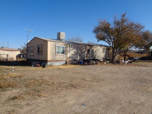 Fantabulous Find!  Older double-wide on 4 acres with huge barn and several stalls.  So much potential...