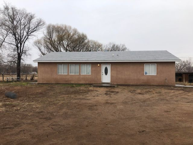 Great home on 1 acre in the country but close to city conveniences. This 3 bedroom 2 bath home is ready for your family and pets. The home has an open floor plan with a lot of natural light and will be perfect for entertaining family & friends. Fully fenced with MRGCD rights. There's a detached 2 car garge and storage shed. Make your appointment today!