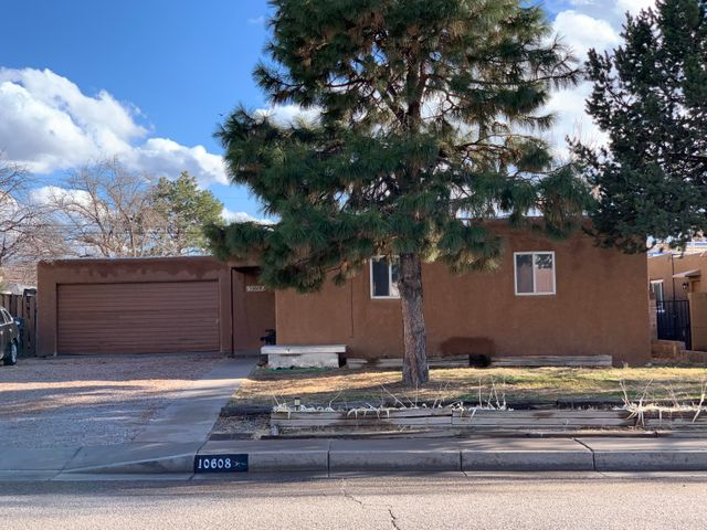 Charming Pueblo Style Home, Features      3 Bedroom 2 Bathroom and 2 Car Garage with a Comfortable and Easy Floor Plan, Wood Fire Place, Spacious Living area,  Plenty of Parking Space, Close to Shopping and Easy Access to Main Streets. Seller offers to have the house painted after closing