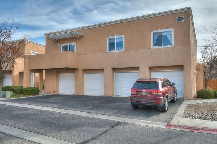 This bright and cozy condo tucked away in Northeast Albuquerque is move in ready and easy to maintain. HOA handles a variety of maintenance for its owners. Very welcoming, open floor plan makes you feel right at home as you walk in. Conveniently located near a city park and community college, this adorable two bedroom home offers a balcony,1 car garage, nice community and much more!