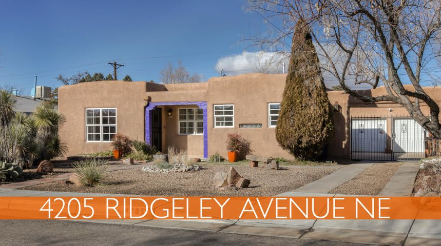 Inviting 3 BR, 1 1/2 Bath Nob Hill Pueblo Bungalow, w/lots of original built-ins & character, plus gorgeous hardwood floors throughout. Light & airy open Living Room/Dining Room w/ unique, tiled, wood-burning fireplace. Fresh paint. Charming eat-in Kitchen, all appliances included. 1/2 bath off separate Laundry area with stacked Washer & Dryer. 3 Bedrooms with Full Bath off main hall. Updated windows, HVAC & electrical. Move-in ready. Front has great curb-appeal. Detached 2-car garage with workspace. Lush, verdant backyard is a floral delight. Backyard is secured by drive-in iron gate and has a Hot Tub, Pergola, built-in outdoor grill, plus beer tap. Backyard has lawn, terracing, auto-sprinklers & drip. Custom vegetable garden enclosure. Walk to Nob Hill Shopping, Dining & Entertainment.