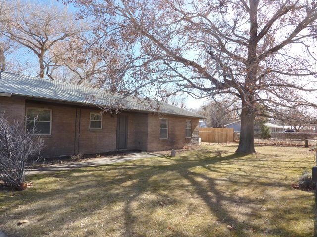 Updated and ready to go! This 3 Bedroom 1.75 Bath located in beautiful Bosque Farms sits on half an acre of valley land nestled in anestablished neighborhood. Comfortable living and privacy. 2 car attached oversized garage . Nicely updated with Pergo flooring, new 50 gal. HW heater and more. Refrigerated air! City water & sewer. Just a quick 15 minutes south of the airport, Bosque Farms offers walking & riding paths, youth sports fields, community center and more.