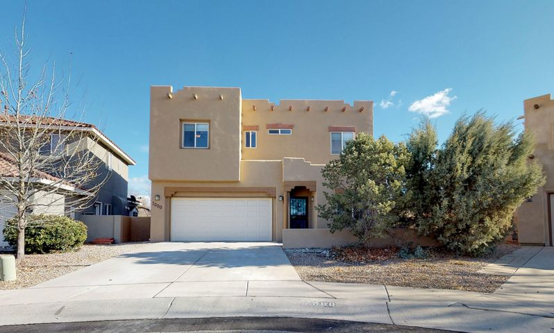 Stunning Vista Del Norte home with an enormous yard and spectacular views! From the spacious kitchen with stainless appliances and generous pantry to the cozy living room and dining room, complete with gas fireplace and filled with natural light from the large windows looking out onto the park-like backyard. Upstairs, the massive master suite boasts a private balcony with gorgeous views of the Sandias in addition to the en suite bathroom with large garden tub and generous walk-in closet. The pie-shaped lot makes for an enormous backyard with views of the mountains and the lush yard and landscaping from the comfort of the picturesque pergola. Along with refrigerated air, the upstairs laundry room, the amenities of Vista Del Norte, and so much more, you won't want to miss this one!