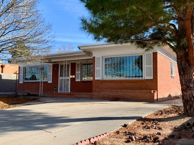 Classic mid-century gem with a new TPO roof (December 2019), Anderson windows, beautiful original wood flooring, 2 living areas, 3 bedrooms and 2 baths.  Detached 2-car garage with electricity.  Located in the heart of the heights, close to UNM North Campus,  shopping, and I-40 access.