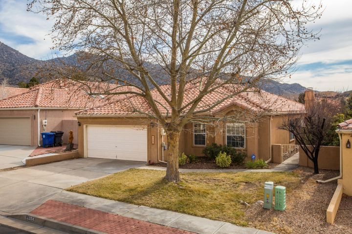 A Super Appealing, Updated, Single Story Home in a Sweet Neighborhood that's literally Steps Away from Mountain Trails & a City Park! Light & Bright with Lots of Windows, Vaulted Ceilings, Spacious Living/Dining Areas & Master Suite provide an Uplifting, Open Vibe. Nice Updates include Newer Wood Flooring, Carpet, Paint, Refinished Cabinetry, HVAC with Refrigerated Air, & Water Heater. Functional Kitchen with Granite, Stainless Appliances, & Large Pantry. Intimate Nook with Private Courtyard offers a Soothing Retreat, while the Inviting Back Yard with Turf & Patio are Great for Entertaining or Rolling Around on the Ground! Close to Sandia Labs, Kirtland Air Force Base, & Major Thoroughfares for an Easy Commute. All Appliances Convey, so Nothing to Do but Move In!!
