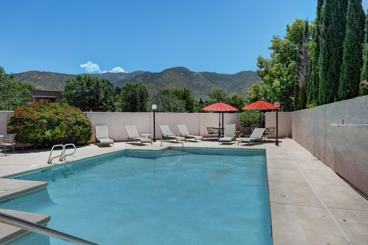 Special Financing Available! Located in the North Foothills with beautiful views of the Sandias from your private bedroom deck. Spacious living space and bedrooms with a new roof and second balcony that faces Tramway. A must see that won't last long! Seller will not be making repairs and has priced it accordingly.