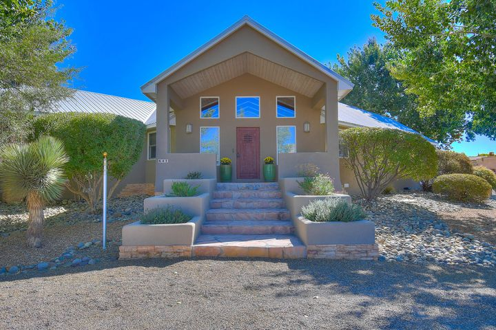 Welcome to this charming, ranch-style  home located in the desirable Bosque Encantado community. This unique and functional flooor plan is all single story, with the exception of one room that is perfect as a second master, guest quarters or hobby space. Step through the front door to a light and bright living space with beautiful views of the Sandia Mountains. Open up the French doors off the living room to enjoy the spectacular outdoor space and quiet surroundings of this gated neighborhood. Located along the Bosque, this is the property for elegant country living. Featuring radiant heat, an updated kitchen with Bosch appliances, beautiful built-ins, spacious bedrooms, beamed ceilings, gas fireplace, and a three car garage. You don't want to miss out on this one-of-a-kind property.