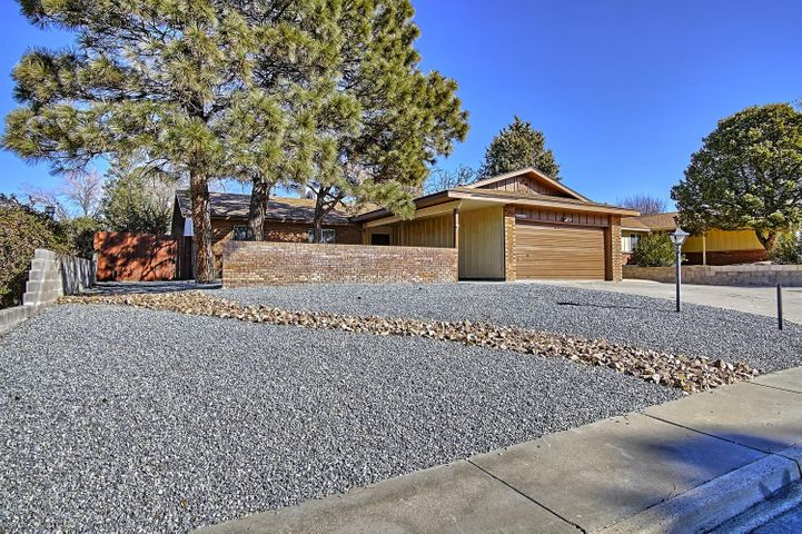 Located in the desirable Academy West neighborhood.  Large living area with a custom brick wood burning fireplace and raised ceilings.   New lighting and fresh paint throughout.   Back yard with covered patio and privacy wall is perfect for entertaining. Fully landscaped and home room for an RV/Boat or other toys. Easy access to interstate 25, Arroyo Del Oso Golf Course, numerous Shops and Eateries.