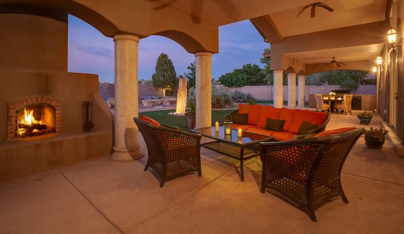 Located in beautiful gated community of Bosque Encantado. Curvy streets shaded by age old Cottonwood trees & the Rio Grande meandering lazily just  a few blocks away. Stunning single story custom home tucked back into a cul-de-sac. Grand entry w/gorgeous custom door welcomes you to open great room w/wall of glass overlooking rear yard. Open gourmet kitchen with Creme Bordeaux granite counters, custom cabinets w/hidden Sub Zero fridge, Wolf 6 burner range, huge walk-in pantry & Butler's pantry. Separate master is luxurious w/spa like bath including huge shower soaking tub, spacious walk-in closet & private courtyard. 2 additional bedrooms,& office/4th bdrm w/private bath. Media/theater room. 60x16 portico w/outdoor kitchen. Refrigerated air..56 ac lot w/putting green