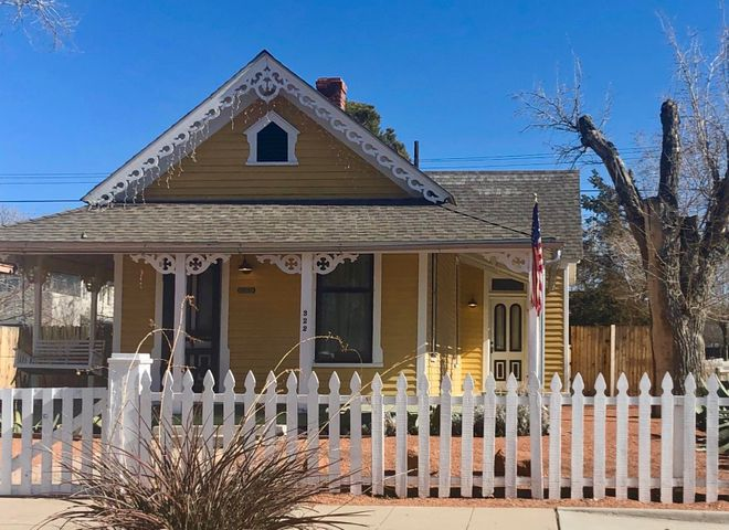 PRICE REDUCTION!!  Rare Updated Carpenter Gothic. 2 bedroom/1 bath.  Featured in June 2019 Albuquerque Magazine and Wikipedia. This charming home is one of the oldest in Huning Highlands (1882). Expertly rehabbed in 2003.  Original clawfoot tub and sink. Original Kitchen cabinets. Copper kitchen counters. Original wood floors and picture rails.  Living room/kitchen/ Master Bedrm have new windows & mini-splits. Gas furnace. Storm windows. Appliances included, Wrap-around front porch. The Seth House has the Original Barn (first Harley Davidson shop in New Mexico) & chicken coops, Shed is coming down with permission & approval of Landmark Commission end of March . Gated Parking on southside of backyard. Gravel landscaping. 3 blocks from restaurants  and ART.