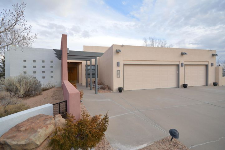 Located on 5 acres, this fabulous four bedroom contemporary home is ideally suited for family living an entertaining. It has a large living room with high ceiling, stacked stone fireplace, lots of windows and large deck with mountain views. Updated kitchen has granite countertops, refinished cabinets, double ovens, large bar and walkin pantry. Spacious first floor master suite has lots of closet space, bath with dual sink vanity and separate shower and tub plus private balcony with hotub and mountain views. Additional first floor rooms include study/office, formal dining room and second living area. Lower level has three bedrooms, bath and large family room with wetbar and access to incredible backyard with inground gunite pool, pond and multiple covered and open patios.