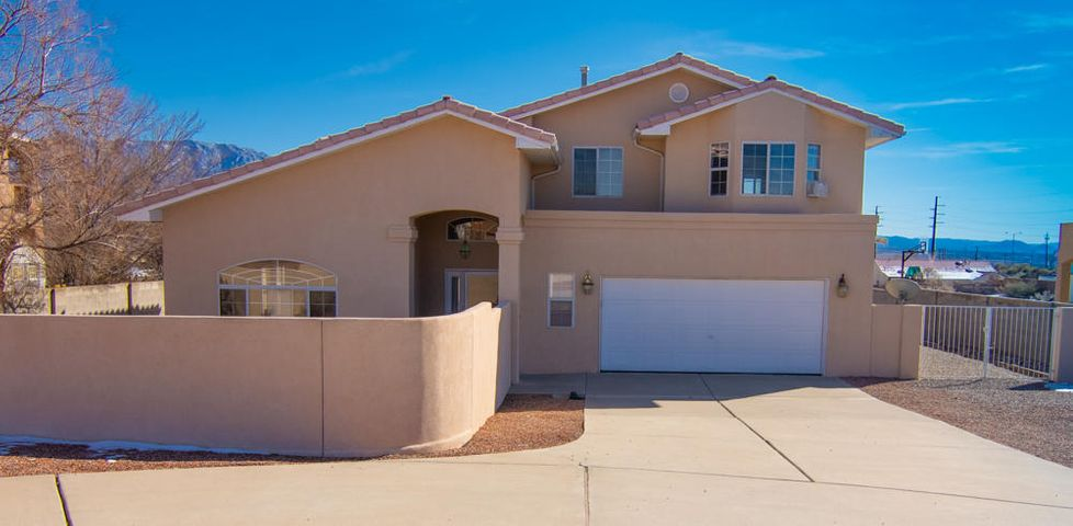 Freshly painted throughout! Spectacular Unobstructed views of the Sandias!! Enjoy soaring ceilings in a flexible floor plan. 2 living spaces both with gas log fireplaces. Eat-in kitchen AND formal dining space. Open/split staircase leads you to Master plus 2 additional BR. Additional views off of 2nd floor balcony. MB includes 2 closets, dual sinks, jetted tub & separate shower. Tile pitched roof, backyard access, spectacular private walled front courtyard. Multiple car owner will be jazzed about spacious circular drive and extra parking. Make this .5 acre oasis your next home!!