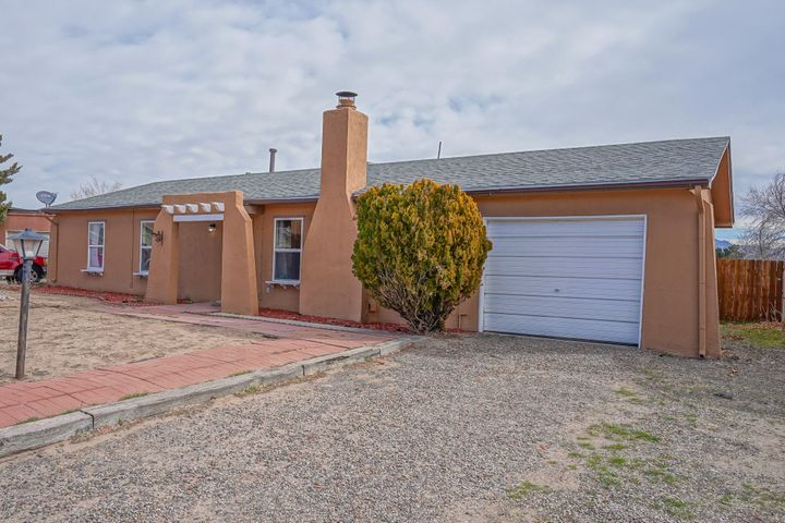 Come uncover this updated Rio Rancho gem with mountain views, before it's gone!  Located in a cul-du-sac, you'll notice this 3 bed/2 bath home has a large lot that helps to maximize your mountain view as well as gives you plenty of room to let your vision unfold. As you walk through, you'll notice there is laminate wood flooring as well as a cozy fireplace that helps make your next home warm and welcoming. In the Kitchen, you'll love the granite countertops and stainless steel appliances. There's plenty of room to make memories with all your guests! You'll find the bathrooms are also updated and this home boasts a new roof! So you can move in, kick back and enjoy your beautiful views from your covered patio. Don't delay, come see what your next home looks like, Today!