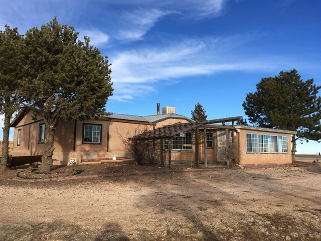 Opportunity Knocks with this manufactured Home on 10 Acres. Large 28 x 40 Workshop Directly behind the Home. Property Sold As Is
