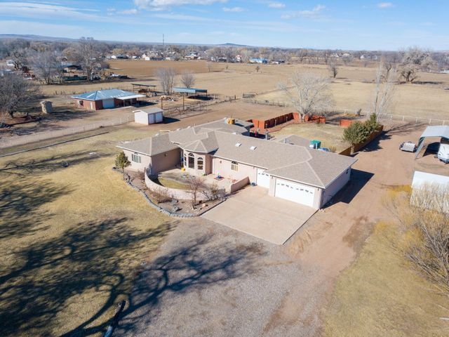 Enjoy country living at its best. Enjoy 4 acres with 2 of them being irrigated pasture. Fully fenced and auto gated entryStunning custom home with 4 large bedrooms 4 baths. This home has 2 living areas and a bonus area for a man cave or game room. Large gourmet kitchen with butlers pantry custom cabinets. Large family dining room.  Master suite has over sized walk in shower, his/her walk in closets and separate vanities. One of the secondary bedrooms has its own bath could be for in-law or teen suite. the other bedrooms have jack and Jill baths plus walk in closets. Enjoy the spacious backyard with in ground pool with liner. lots of patio space perfect for entertaining. Make this a must see