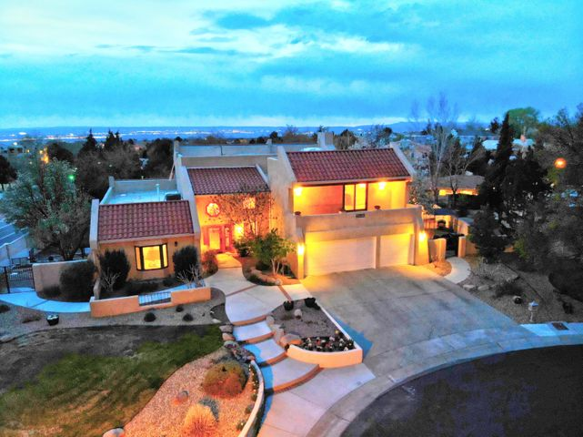 Embrace the flawless finishes of this 5 bedroom home, set on a half acre in the prestigious, gated Tanoan community!The gracious foyer invites you to the living room with a display of windows climbing to the cathedral ceiling,illuminating wood flooring throughout the home with natural light.Wet bar leads to cozy family room w/fireplace. Kitchen unfolds w/granite counters and new double oven.The formal dining room is adjacent to the temperature controlled wine cellar.Master suite features a walk-in closet,spacious master bath and balcony with expansive mountain views.4 generous bedrooms on main floor with walk-in closets-paired w/ 2 jack-n-jill bathrooms.Picturesque backyard is an entertainer's paradise with a fountain,deck and 2 spacious patios. New TPO roof & carpet(2019) and newer stucco