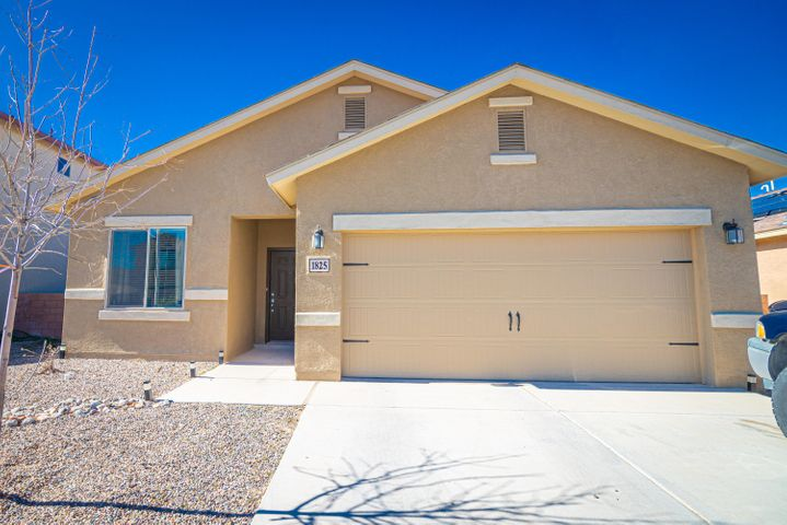 A welcoming air and brightness abound in this like-new LGI Home in Rio Rancho. Interior boasts ceramic tile, high ceilings, granite counter tops, stained maple cabinetry,walk-in master closet, and separate laundry/utility room. Enjoy a covered rear patio and walled back yard on the exterior, as well as a landscaped front and two-car attached garage. Within minutes to dining, parks, shopping, and numerous other local amenities as well as easy access to NM-528 to reach Bernalillo and/or Albuquerque. Come and see this one while it lasts!