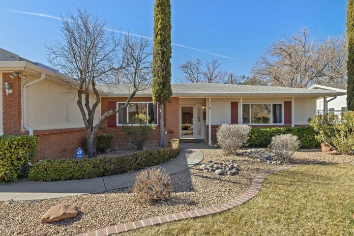 Lovingly cared for, one owner, single level, ABQ Country Club home ready to find a new buyer! Close to downtown, UNM, and museums.  Bring your touches to this charming home situated in a highly walkable neighborhood!  Floor plan will accommodate various living styles with 3 living areas, several bedrooms with hardwood flooring, newer double paned windows throughout. One of the bedrooms has an attached living space and outside door which could be used as an inlaw suite or office. Kitchen has quartz countertops and high quality oak cabinets. Spacious laundry room.  Workshop in the back yard with automatic sprinklers and spacious 2 car garage attached to the home. Come see this house soon!