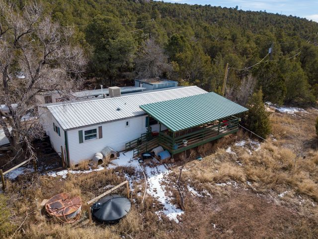 Great property wit two huge metal garages and carport. Home is sold as is. Title was not deactivated. Cash or Owner financing only.