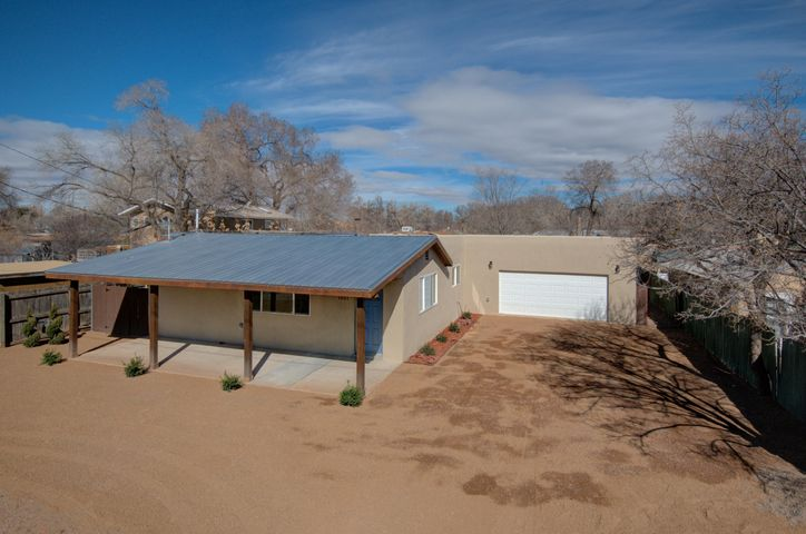 Stunning remodel located in the North Valley off of 12th Street and Candelaria.  Main house offers 3/Bed 2/Bath and In Law Suite offers 1/bed 1 Bath.  House features new kitchen, new bathrooms, new flooring, new landscaping and new stucco to name a few. Expansive great room the opens to the kitchen with white cabinets,  soft close cabinetry and drawers, stainless steel appliances, granite counter tops and recessed lights, kitchen island with bar. Oversize 2 car garage with extra storage space or workshop area.  Fully landscaped front and back.  Spacious circular and extended driveway to accommodate more vehicles and easy circulation.  TPO and metal roof.  So many features to offer and enjoy with this North Valley home.  Call today to schedule your showing!