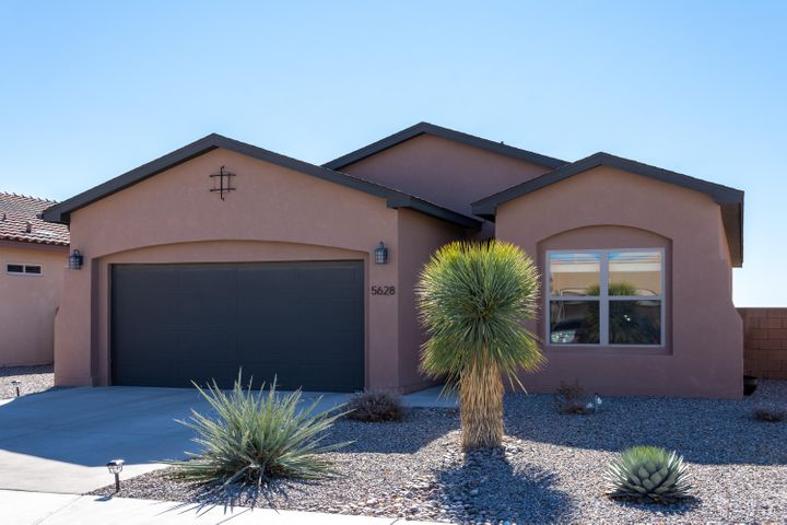 Open House, Sat, 2/15/20, 2-4pm.  Outstanding, one of kind property that borders the Petroglyph National Monument and with full views of the Sandia Mountains!! Immaculately maintained one-story home with open living area, large chef's kitchen, oversized finished garage, lovely master suite with luxurious master bath, 95% efficiency furnace, R60 ceiling insulation. Professionally installed back yard with irrigation, low voltage lighting and raised deck for fabulous sunset and sunrise views.