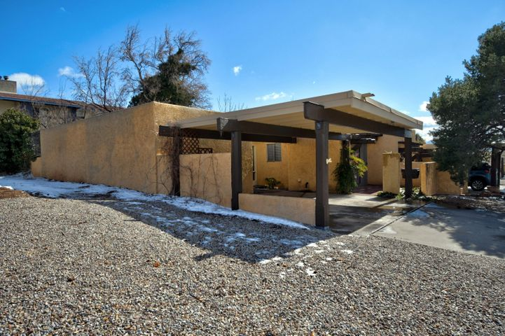 Charming townhome tucked away on a corner lot in the back of a small community close to the Sandia Mountains!! Updated kitchen, fresh paint and brand new carpet!! Spacious living area with a fireplace! Private back yard!  HOA includes Sewer/Water!
